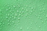 Water droplets on green — Stock Photo
