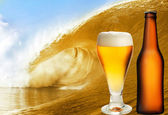 A beer glass and bottle over beer wave — Stock Photo