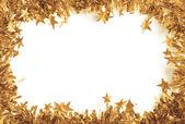 Enfeites de natal ouro como uma fronteira isolada contra um fundo branco — Foto Stock