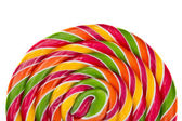 Lollipop candy on white background, rainbow colours — Stock Photo