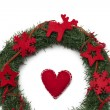 Christmas wreath with red heart - Stock Photo