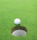 The ball at the hole on the golf course — Stock Photo