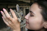 Closeup portrait of a pretty girl with a rabbit — Stock Photo