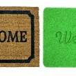 Welcome mats isolated over white — Stock Photo #21194641