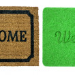 Welcome mats isolated over white — Stock Photo