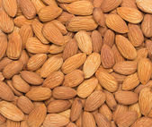 Pile of almonds close-up as background. — Stockfoto