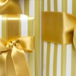 Gold gift boxes background — Stock Photo #23681385