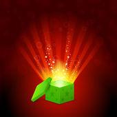 Beautiful magic light shining from a green gift box — Stock Vector