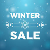 Winter sale and in the middle snowflake — Stockvektor