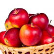 Red apples in wicker basket - Stock Photo