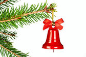 Spruce twig and Christmas bell — Stock Photo