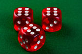 Dices on the green cloth. — Stock Photo