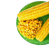 Corns on green plate — Stock Photo