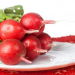 Bunch of radishes on white dish  — Stock Photo