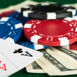 Chips, money, cards on poker table — Stock Photo