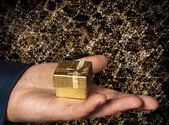 Gift in gold box — Stock Photo
