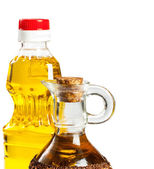 Bottle and glass cruet for oil — Stock Photo