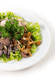 Plate with mushrooms salad greens — Stock Photo