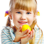 Sweet little girl with yellow Easter egg — Stock Photo
