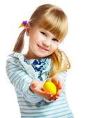 Sweet little girl with yellow Easter egg — Stock Photo