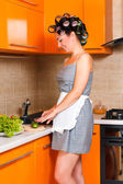 Middle-age beautiful woman in the kitchen with knife — Stock Photo