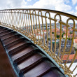 Stock Photo: Steep spiral stairs above city