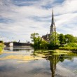 Church by the lake - Stock Photo