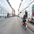 Stock Photo: Riding bicycle in city, motion blur
