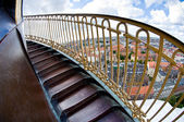 Steep spiral stairs above the city — Stock Photo