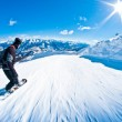 Stock Photo: Snowboarder riding fast, motion blur, fisheye shot