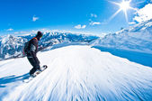Snowboarder riding fast, motion blur, fisheye shot — Stock Photo