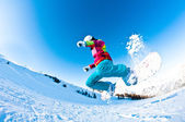 Girl snowboarder having great fun jumping — Stock Photo