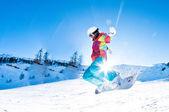 Girl snowboarder having great fun jumping — Stock Photo