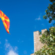 Stone castle and Macedonian flag — Stock Photo