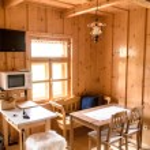 Wooden log cottage cozy interior — Stock Photo