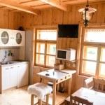 Wooden log cottage cozy interior — Stock Photo #49862855