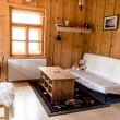 Wooden log cottage cozy interior — Stock Photo #49862877