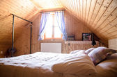 Wooden log cottage cozy interior — Stock Photo
