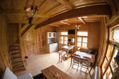 Wooden log cottage cozy interior — Стоковое фото