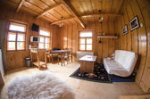 Wooden log cottage cozy interior — Stok fotoğraf