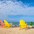Stock Photo: Summer scene with colorful lounge chairs at tropical beach in Floridwith blue sky and ocean