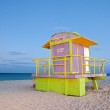 Summer scene in Miami Beach Florida with a colorful lifeguard house — Stock Photo #24826877