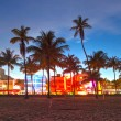Stock Photo: Miami Beach, Florida hotels and restaurants at sunset on Ocean Drive