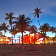 Stock Photo: Miami Beach, Floridhotels and restaurants at sunset on OceDrive