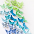 Multi-colored sugar butterflies on a white background — Stock Photo