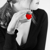 Girl with toy heart — Stock Photo