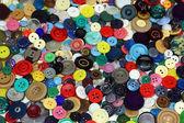 Botones vintage como fondo de colores — Foto de Stock