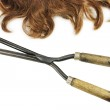 Vintage curling tongs and waved hair — Stock Photo