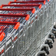 Stock Photo: Shopping carts in rows