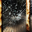 Cracked glass and bars — Stock Photo